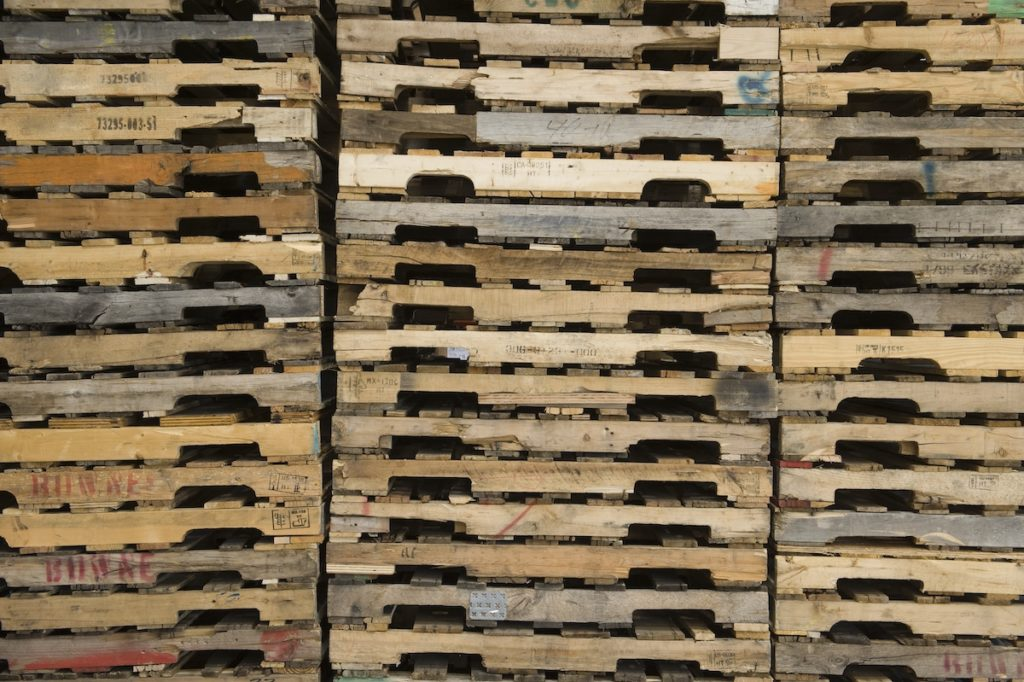 three stakes of pallets